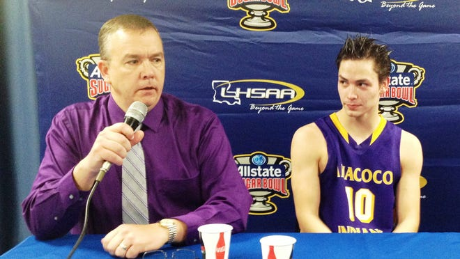 Anacoco senior guard Sam Turnipseed (10) listens as coach Tracy Reese speaks during the post-game press conference following the Indians' win over Fairview in the Class B quarterfinals.