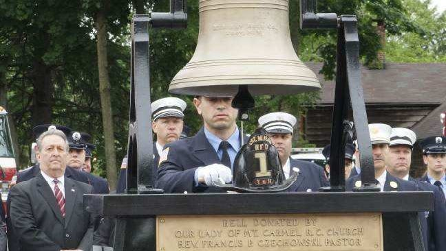 Nutley firefighter Michael LaCorte recognizes a fallen comrade on May 28, 2018, during the dedication of the Public Safety Department's firefighters memorial.