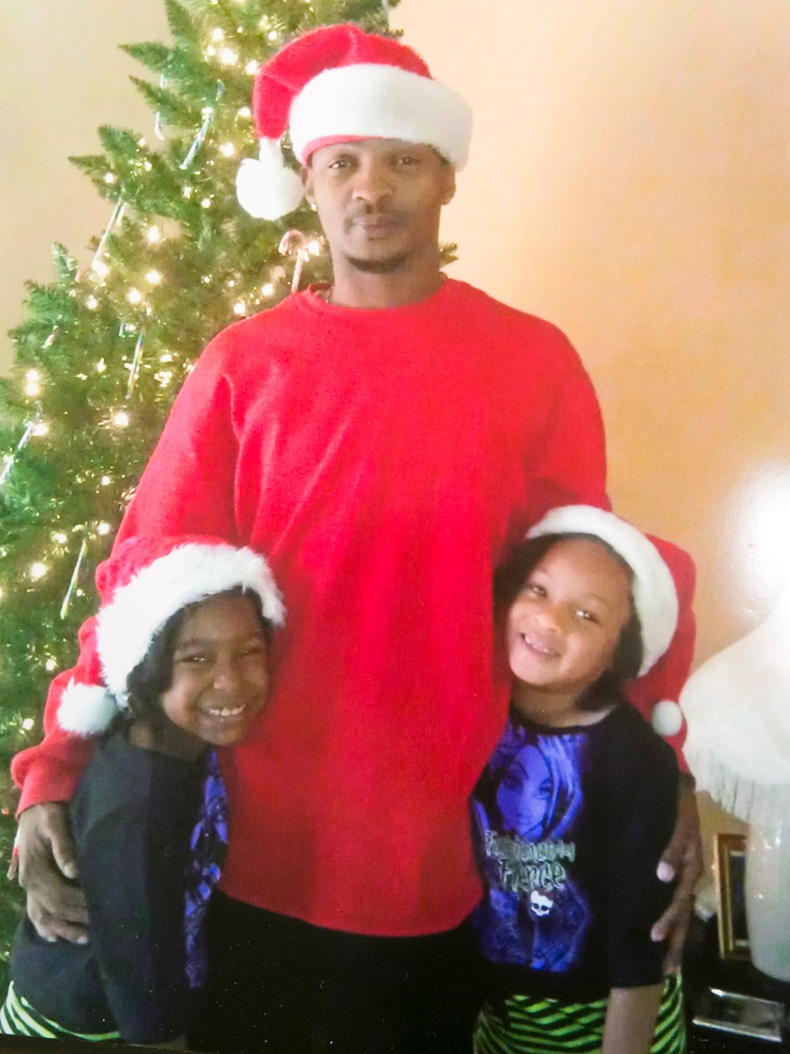 Rumain Brisbon with two of his daughters in December