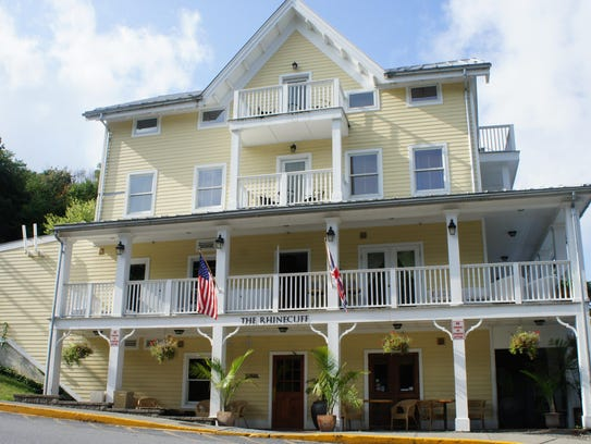 The Queen Anne style Rhinecliff Inn is set at the base