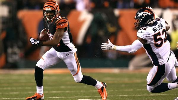 Cincinnati Bengals wide receiver Brandon Tate returns a kick off getting away from Denver Broncos outside linebacker Corey Nelson (52) during the fourth quarter at Paul Brown Stadium Dec. 22.