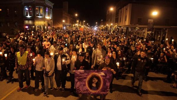 A crowd estimated by the city at 10,000 people turned out to honor Hailey Owens on Feb. 22, 2014. Stacey Barfield, Hailey's mom, and her husband, Jeff Barfield, are pictured to the left of the poster of Hailey.