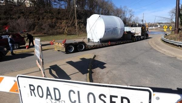 A tractor trailer stages with a large piece of equipment before delivery to the New Belgium brewery Tuesday morning at the intersection of Haywood Road and Craven Street. The equipment is one of many oversized deliveries expected this week to the New Belgium facility.