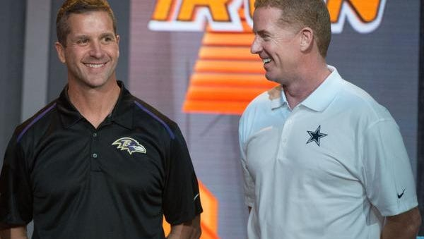 Ravens head coach John Harbaugh (left) and Dallas Cowboys head coach Jason Garrett are stars in the video.