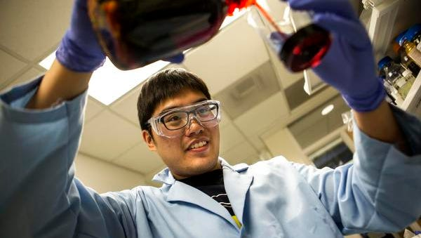 Siu On Tung, a doctoral student at the University of Michigan and a member of professor Nicholas Kotov's research group, works on the battery breakthrough that will be used in Elegus Technologies' product. Elegus plans to launch manufacturing as soon as the fourth quarter of 2016.