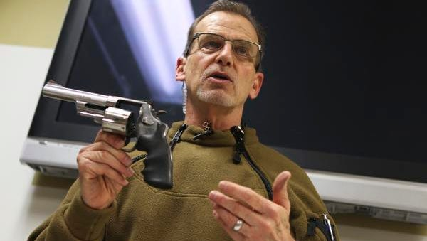 Barry Laws, CEO of Open Range and weapons instructor, points out a revolver's specifics during a concealed weapons permit class at the Open Range gun range. In Kentucky,  a concealed weapons permit is granted only after passing a background check, a written exam and a shooting qualification test.