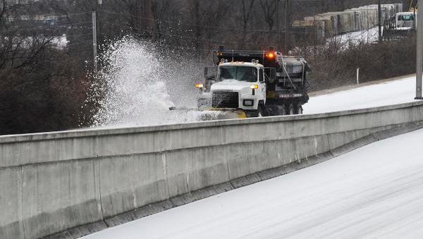 TDOT salt trucks works the north bound exit I-65 at Armory Drive Nashville, Tenn. February 16, 2015.