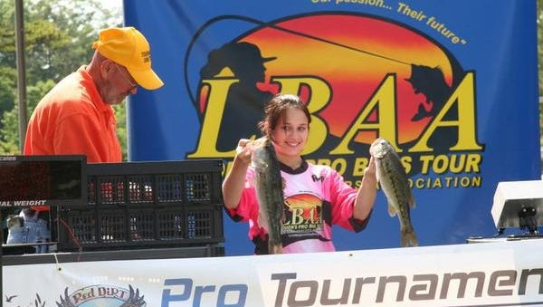 Danielle Worthen holds up a couple of bass during a Ladies Bass Anglers Association tournament at Lake Hartwell in 2011.