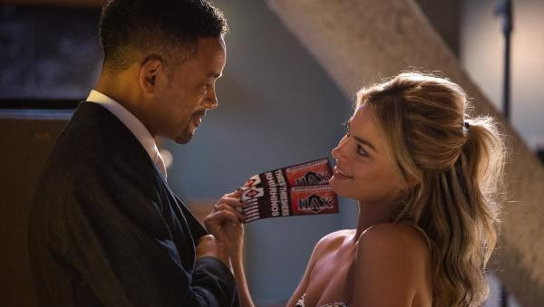 Will Smith, left, as Nicky and Margot Robbie, as Jess, star in 'Focus.'