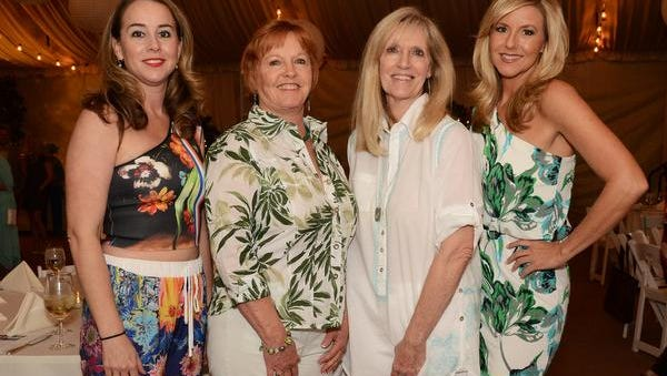 """Paddles of two sorts were the center of attention on a recent balmy night in the desert, as the powerful women of Girlfriend Factor welcomed 150 guests to their 8th annual Club Cabana: """"Unleashed and Uncorked!"""" fundraising dinner at Toscana Country Club."""