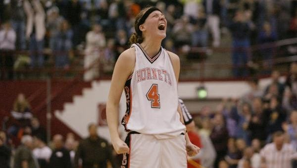 3/1/03.  Katie Gearlds of Beech Grove reacts immediately after hitting three straight freethrows to send their game with North Harrison to overtime.  Beech Grove riding Gearlds' 46 points prevailed in double overtime.  Class 3A semi-state action from Southport HS.  (Robert Scheer Photo) w/story file 81220