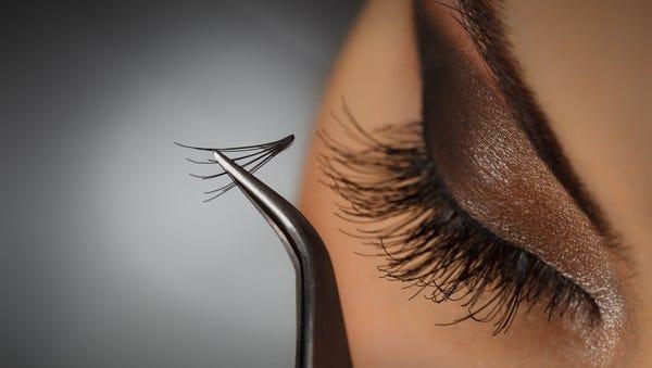 Demonstration of eyelash extension application.