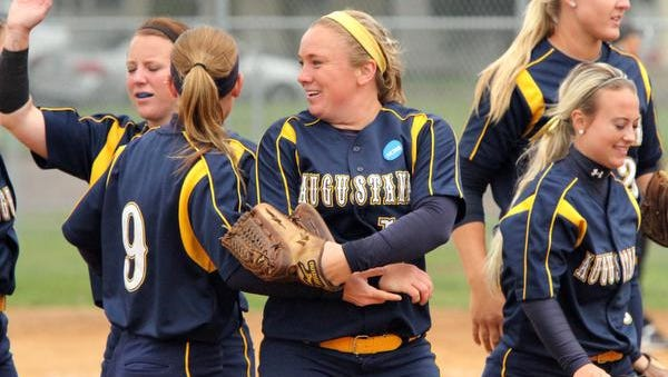 Janelle Trautmann of the Augustana Vikings celebrates with her teammates after the team won the Central 1 Region against East Central University on Sunday at Bowden Field in Sioux Falls.
