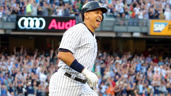 New York Yankees designated hitter Alex Rodriguez (13) runs up the first base line after hitting a solo home run against the Detroit Tigers during the first inning at Yankee Stadium. The hit was also the 3000th of his career.