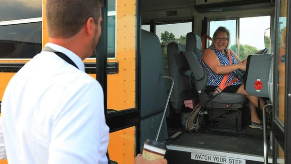 West Clark Superintendent Chad Schenck greets bus driver Jane Sierota outside of Silver Creek Elementary School on Wednesday morning on the first day of classes in the district.July 29, 2015