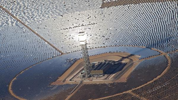 Thousands of heliostats focus solar energy on on a central boiler at the top of a solar power tower at the Ivanpah Solar Power Facility in the Mojave Desert, Tuesday, October 21, 2014.  Ivanpah is the world's largest solar thermal power station.