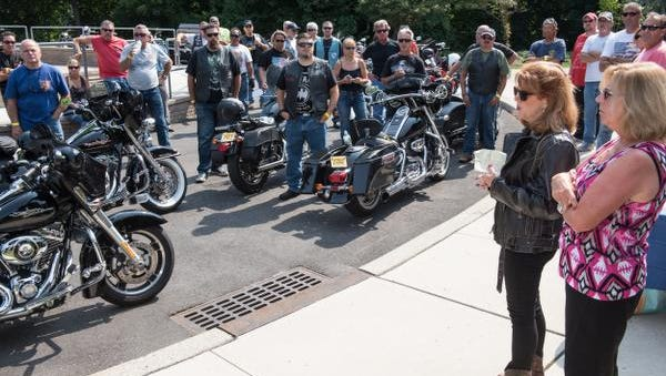 "Susan Pellone-McCoy, (wearing cowboy boots) VP, Board of Directors, MHA speaks before the ride begins.Behind her is Wendy DePedro, (RIGHT)  Executive Director, MHA. The motorcycle ""Ride for Patriots""  from the Vietnam Veterans Memorial in Holmdel to Manasquan on Sunday, August 30, 2015, was to help raise awareness of the mental health services that MHA offers to military and all families in Monmouth County. /Russ DeSantis/Special to the Asbury Park Press / SLUG-asb 0831 ride for patriots"