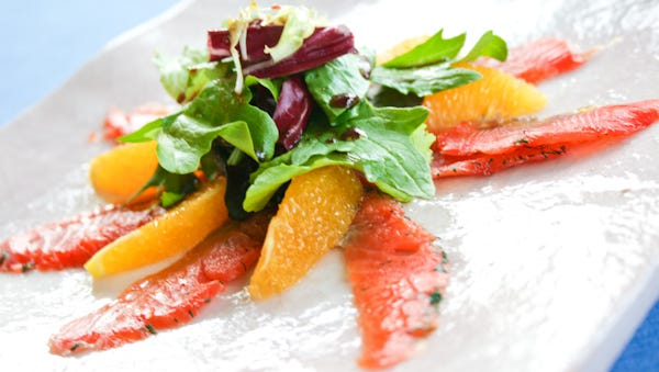 A simple salad is made from gravlax and a pomegranate balsamic dressing.