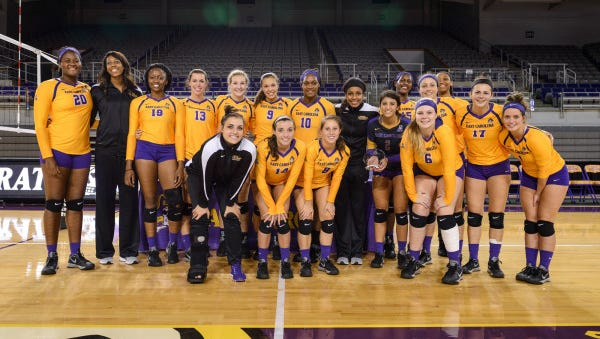 Reynolds alum Natalie Montini (back row, fifth from left) is a member of the East Carolina volleyball team.