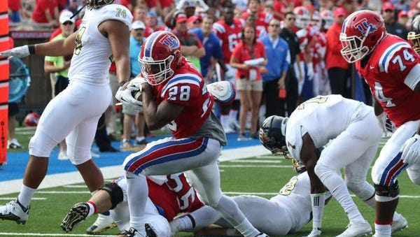Louisiana Tech running back Kenneth Dixon scores one of his three touchdowns in Saturday's win over FIU.