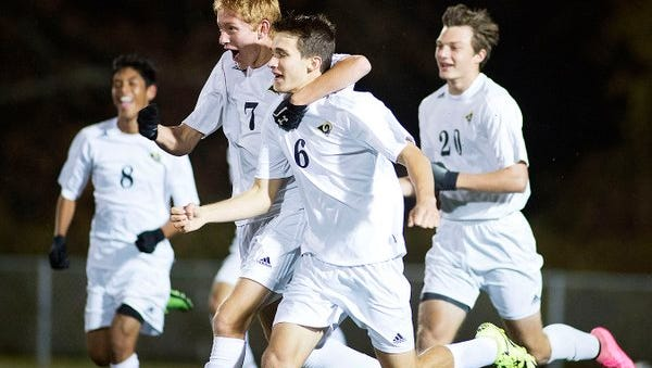 Roberson players celebrate after Monday night's first goal.