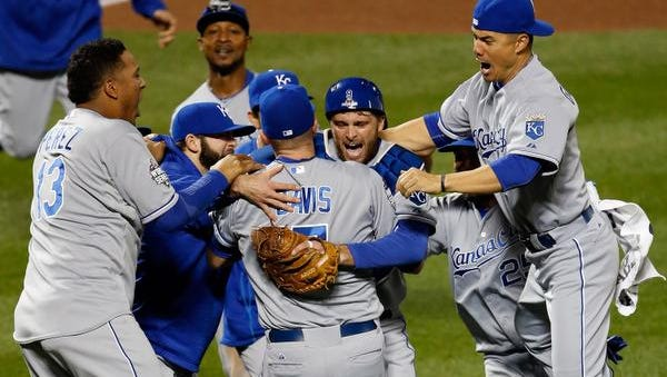 Wade Davis (17) of the Kansas City Royals and catcher Drew Butera  of the Kansas City Royals celebrate with teammates after defeating the New York Mets to win Game Five of the 2015 World Series at Citi Field on November 1, 2015 in the Flushing neighborhood of the Queens borough of New York City. The Kansas City Royals defeated the New York Mets with a score of 7 to 2 to win the World Series.