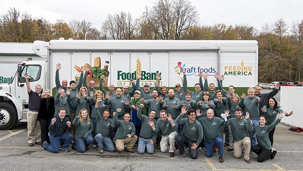 Chesapeake Utilities Corp. employees pose while volunteering at the Food Bank of Delaware's Milford location.