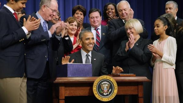 Members of Congress, education leaders and students applaud after  President Barack Obama signed The Every Student Succeeds Act during a ceremony in the Eisenhower Executive Office Building Thursday.