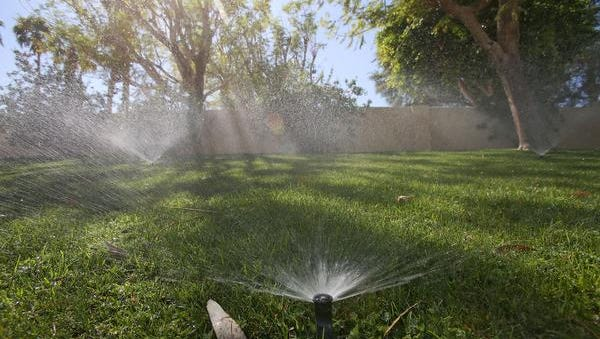 Sprinklers water the grass at a home in Bermuda Dunes.
