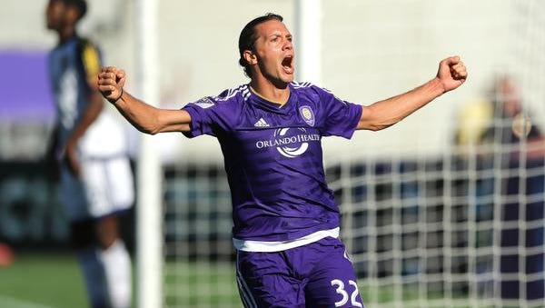Adrian Winter #32 of Orlando City SC celebrates his game tying goal in overtime during a MLS soccer match between Real Salt Lake and the Orlando City SC at the Orlando Citrus Bowl on March 6, 2016 in Orlando, Florida. The game ended in a 2-2 draw.
