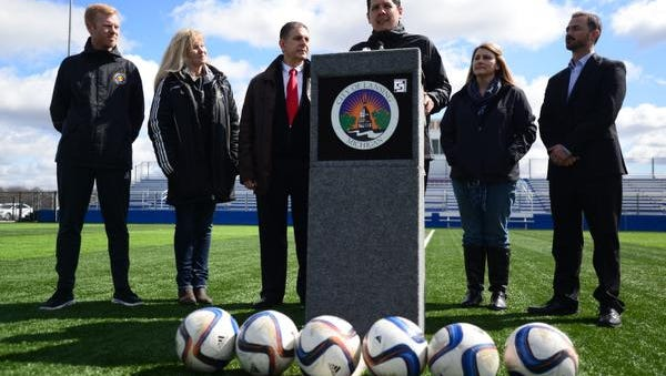 Jorge Eufracio, head coach of a new Women's Premier Soccer League team in Lansing, speaks during a press conference at the Hope Sports Complex in Lansing. From left to right behind Eufracio, Chill SBC Executive Director Ben Jones, Chill SBC Soccer Club owner Julie Mullin, Mayor Virg Bernero, Lansing City Council member Tina Houghton and Mike Price, executive director of the Greater Lansing Sports Authority.