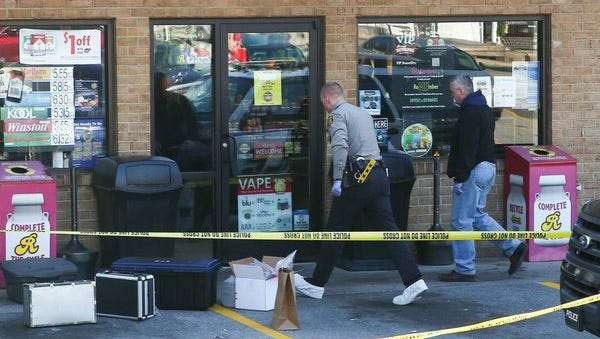 Police work at the scene of a police incident at Rutter's on Broadway in Hanover.