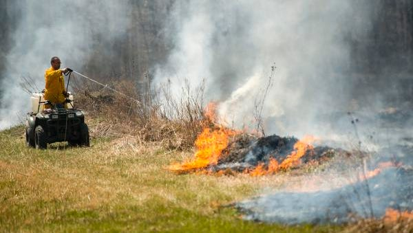 Controlled burns, like this one in Sandusky County on Monday, are planned for the Ottawa National Wildlife Refuge between now and May 15.