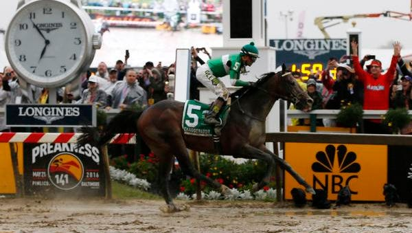 Kent Desormeaux aboard Exaggerator (5) wins the 141st running of the Preakness Stakes at Pimlico Race Course.