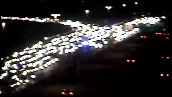 A vehicle collision and fire caused a mile-long backup of traffic on Loop 101 near University Drive late Saturday night.