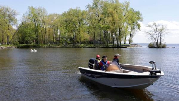 John Iglar of Appleton guides his boat out to Lake Winnebago with his wife Sharon, left, and daughter Laura, right, Tuesday, May 17, 2016, at Jefferson Park in Menasha, Wisconsin. Iglar was taking out the boat for a test run in preparation for a future fishing trip in Canada.
