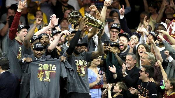 LeBron James of the Cleveland Cavaliers holds the Larry O'Brien Championship Trophy after defeating the Golden State Warriors 93-89 in Game 7 of the 2016 NBA Finals on Sunday night in Oakland, California.