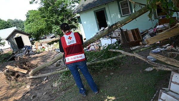A Red Cross employee surveys the damage in White Sulphur Springs, W.Va.