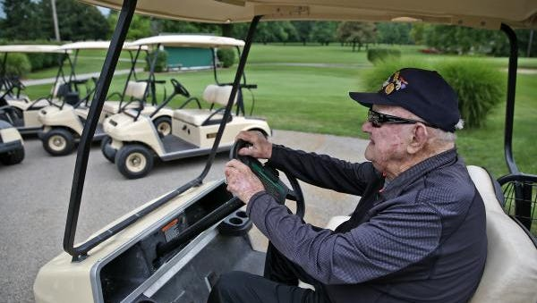 Bob Crouch sits in a golf cart and looks out on Thatcher Golf Course, Tuesday, July 26, 2016.  The World War II veteran was an avid golfer who golfed with many famous people throughout the years, from Elvis to George H.W. Bush.