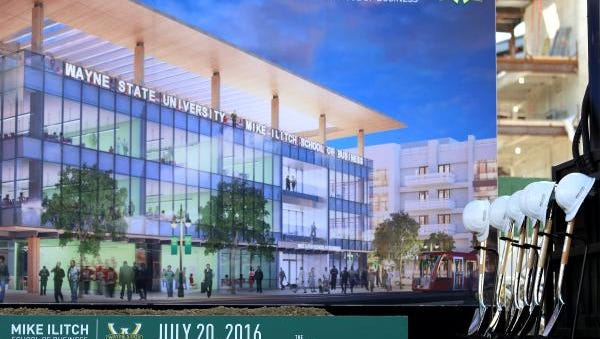 Rendering for the Wayne State University's Mike Ilitch School of Business on stage with the shovels and ceremonial helmets before the at the groundbreaking ceremony on Wednesday, July 20, 2016. Jessica J. Trevino