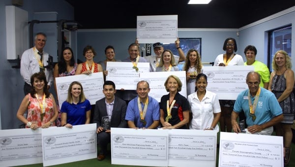 Recipients of organizations awarded checks from the proceeds of the 2016 Treasure Coast Marathon show off their checks at a recent reception.