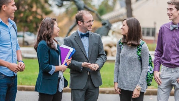 Dean of Admissions Justin G. Roy, center, speaks with students.