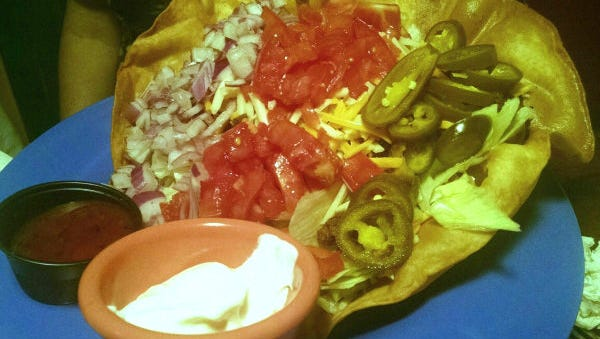 Chubbies' taco salad was a large, fried flour tortilla filled with crisp iceberg lettuce, seasoned ground beef, mixed shredded cheese, tomatoes, red onion, jalapenos and sour cream.