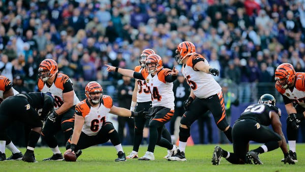 Cincinnati Bengals quarterback Andy Dalton (14) resets the offense in the fourth quarter of the NFL Week 12 game between the Baltimore Ravens and the Cincinnati Bengals at M&T Bank Stadium in Baltimore on Sunday, Nov. 27, 2016. The Bengals lost to the Ravens 19-14, falling to 3-7-1 on the season.