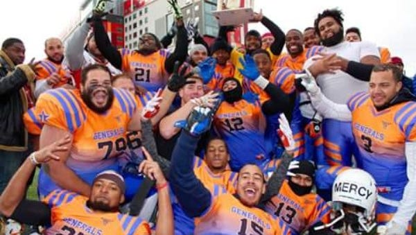 Members of the York Generals semi-pro football team celebrate after winning the Independent Football League championship in November.
