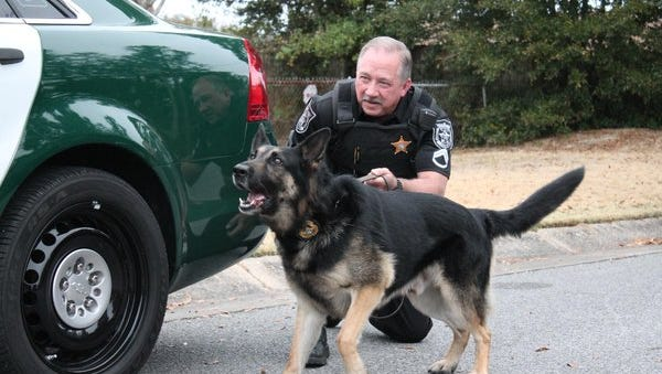 Escambia County Sheriff's Office deputy Tim Taylor with retiring K-9 Rex in 2015. Taylor entered a written plea of not guilty to Judge Ross Goodman in Santa Rosa court during felony arraignments Thursday.
