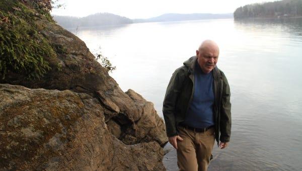 Larry Pounds explores the shore of Watts Bar Reservoir.