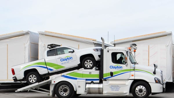 Clayton Homes is launching its Clayton Home Transport division to provide in-house transportation of its manufactured homes. The truck here is configured to haul its own escort vehicle.