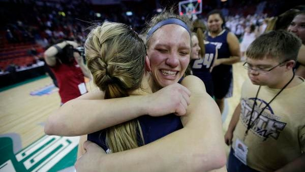 Appleton North High School's Sydney Levy, left, and Callie Pohlman celebrate their victory against De Pere High School during their WIAA Division 1 State Tournament final girls basketball game Saturday, March 11, 2017, at the Resch Center in Ashwaubenon, Wis.