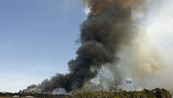 U.S. Forestry Service and the Florida Forestry Service work to contain a massive wildfire in Hernando Beach April 8.